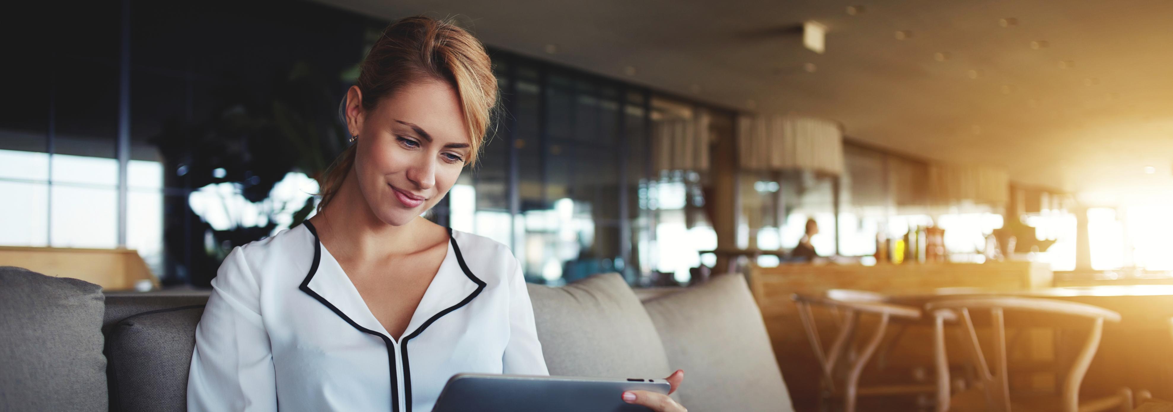 blonde woman on tablet investor relations websites